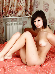 Gorgeous babe Lubochka shows off her tits and spreads her pussy