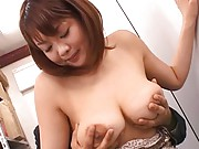 Japanese AV Model gets naked and her tits are teased from behind