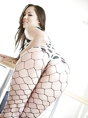 Kristina Rose in vinyl polkadot lingerie and fencenet stockings