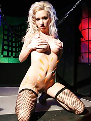Hillary Scott in black fishnets and body paint