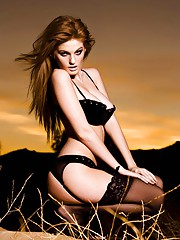 Faye Reagan in the sunset in black lingerie and stockings