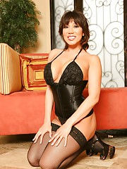 Ava Devine busting out of her corset and fishnet stockings