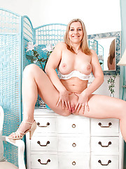 Wild cougar Tonya spreads her pussy while on top of a cabinet