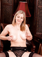 Anilos babe Tonya slips off her thongs and spreads her pink milf pussy