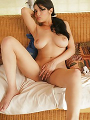 Natalia Spice gets out of her lace halter top and plays with her naked body in bed