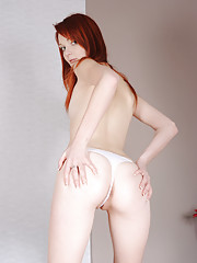 Maggies makes the most of her time on camera with this sultry pictorial starring her redheaded beauty, pale milk soft skin and that tight twat between her legs. An orange beaded sex toy and her own na...