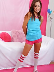 Gigi Rivera masturbates with her pink and white toy wearing just high socks