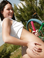 Fixing her tire with a large masturbating toy