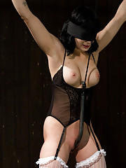 Asphyxia Noir in predicament bondage, dildo fucked with pussy clamps, whipped up, caned hard, vibed into orgasm.