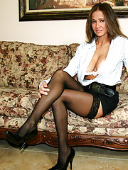 HotWifeRio puts on a pair of sexy stockings and sucks on a huge cock