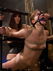 Petite gorgeous sub is bound in restrictive bondage and mercilessly strap-on on fucked.
