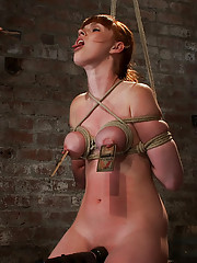 Sexy Irish red head with HUGE lactating nipples severely bound in a reverse prayer, flogged to a bright pink, suffers nipple torture, MADE to orgasm!