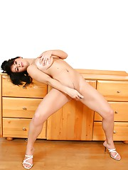 Busty brunette loves masturbating using a toy