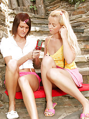 Two hot lesbian girls enjoy screwing outdoors