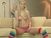Madison looks cute as she plays with her body wearing nothing but rainbow high socks
