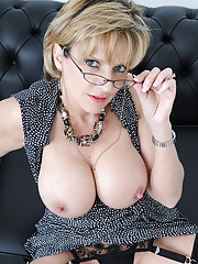 Deep cleavage and nylons mature