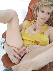 Busty hot mature fingers her cunt
