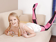 Goldie is a petite pussy model with an adventurous sense of style. Her crotchless stockings are bright pink like her pussy and black like the deviant ideas in her mind. Watch the way she holds her sex...