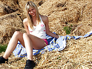 Rubbing her stunning teenage body outdoors