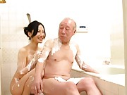 Misa Arisawa washes man with her full of soap big melons