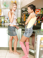 Horny teenagers in their kitchen massaging