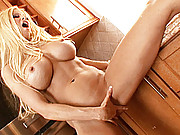 """""""Gina Lynn plays with her pussy after stripping down and showing off her pink pussy"""""""