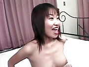 Asian schoolgirl gives small cock a blowjob