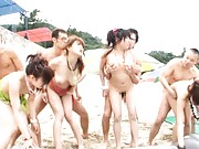 Japanese AV Model deeply doggy fucked in orgy on the sandy beach