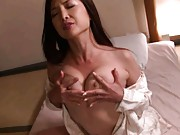Chisa Kirishima holds her big tits in her and gets pussy wet