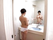 Miki Sato naked and with huge  jugs washes a stud´s back