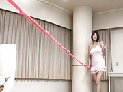 Japanese AV Model rubs pussy with very long pink rope