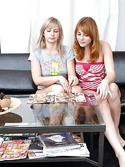 Adorable teen lesbians kissing in living room