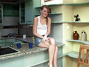 Adorable naked chick masturbates in kitchen
