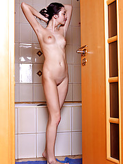 Sexy Nubile Anya taunts her clitoris with the pressure from a shower head