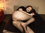 Asami Ogawa shows pussy through fishnet stockings and thong