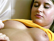 Girl pleasuring pussy with television remote