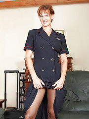 MILF flight attendant Liddy strips off her uniform and spreads in here