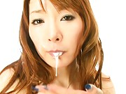 Kou Minefuji Lovely Asian babe has two cocks to suck in a trio