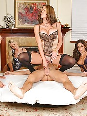 3 big tits milfs take advantage of their boy toy by commanding him to eat them out after spinning on a wheel of pussy