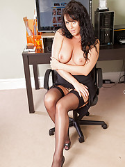 Classy business woman Leah flaunts her sultry milf body in the office