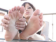 Risi plays with her feet