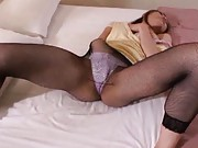 Emi Harukaze Asian babe takes off her fishnets to masturbate