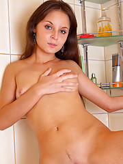 Nude brunette Katia gets slippery and wet in the shower
