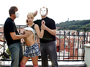 Girl shagging two older dudes on a balcony