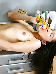 Natalya pours milk on her body and uses a banana to pleasure herself