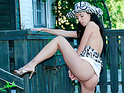 Naughty teen in a cowboy hat masturbates in her front yard