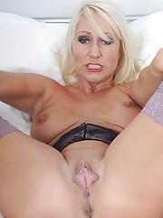 Mature spreads her thick cunt lips