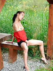Wild honey Natali Sweets plays with her pussy on a park bench outside