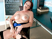 Horny school teacher plays with her pussy in the classroom