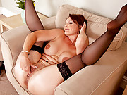 Stunning red headed milf Foxy fingers her slick pussy